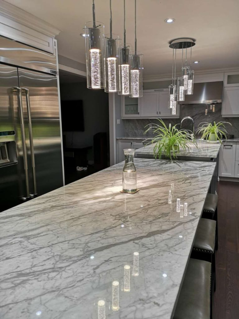 Premium Kitchen Design with Natural Countertops Design by Moose Basements