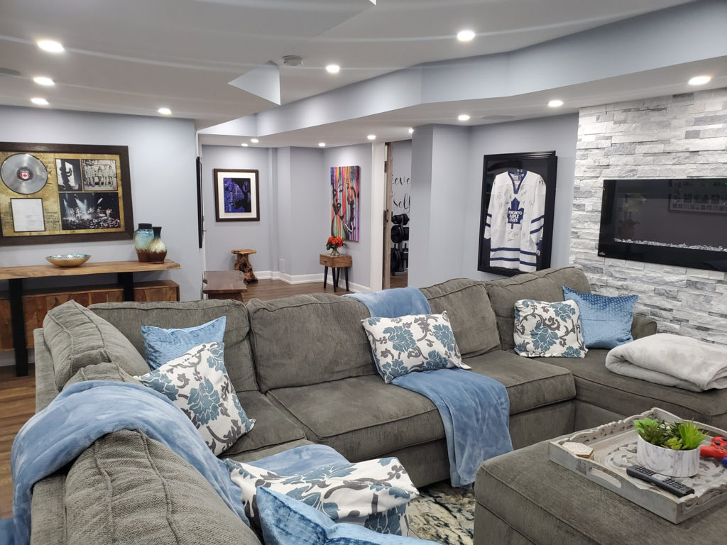 luxury living room with ceiling potlights - custom basement renovation