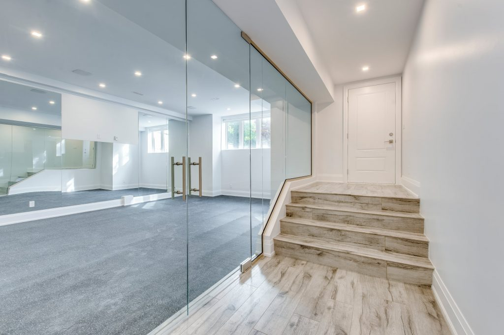 custom basement with glass enclosure between 2 rooms - basement renovations