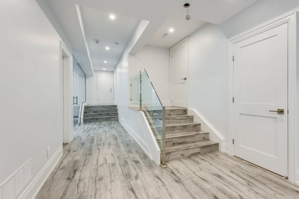 Luxury Staircase in Basement with Glass Railings - Finished Basements Toronto