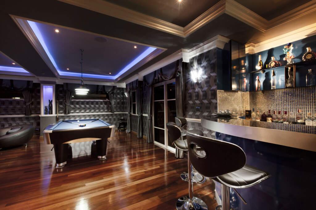 Modern Basement with Custom Bar and Pool Table - Basement Remodeling Burlington
