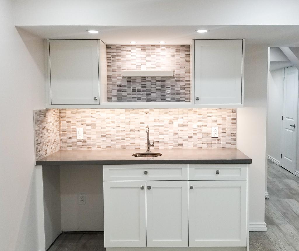 Small Basement Kitchen with Backlit Kitchen Cabinets - Basement Remodeling Company Brampton