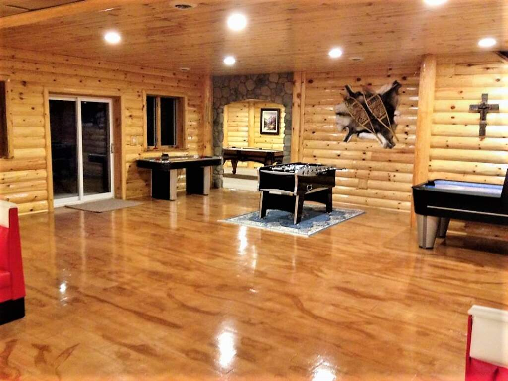Custom Basement Game Room with Wooden Floor and Walls - Basement Finishing Company Mississauga