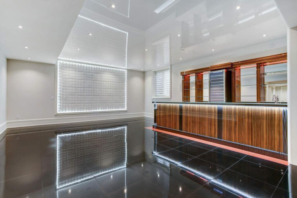 High Gloss Ceiling and Floor in Custom Basement Finishing Project Burlington