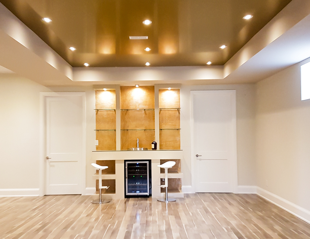 Basement Family Room with Reflective Ceiling and Custom Bar - Basement Design Milton