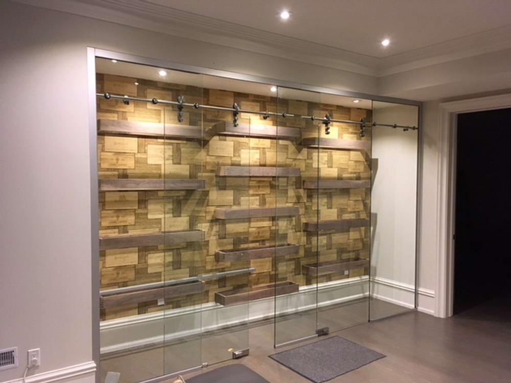 Custom Wall Unit with Glass Sliding Doors - Basement Design Nobelton