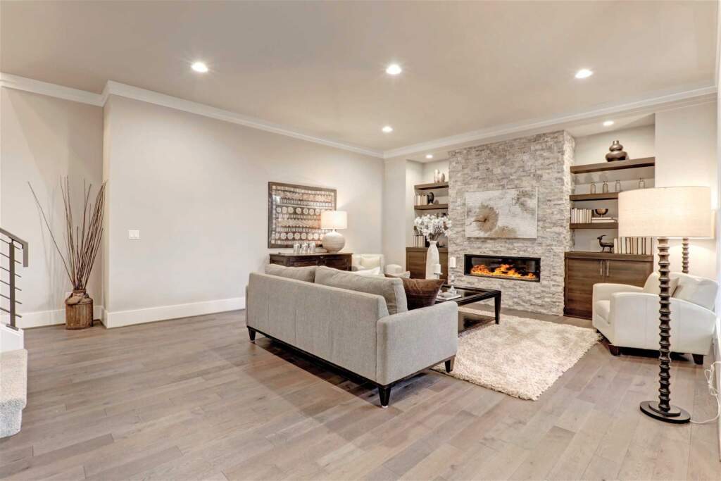 Basement Modern Family Room with Brick Wall Decor and Build in Fireplace - Basement Remodeling Nobleton