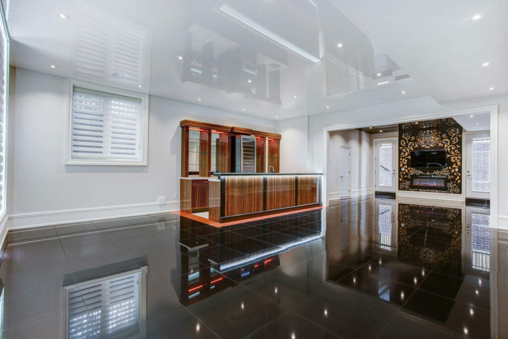 Reflective Ceiling and Floor in Amazing Basement Design by Moose Basements Renovation Company Toronto